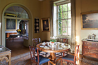 A round table laid for a meal of boiled eggs in the breakfast room, which adjoins the reception room