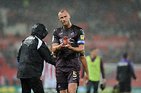 Mike van der Hoorn of Swansea City applauds the fans at the final whistle of the Sky Bet Championship match between Stoke City and Swansea City at the Bet 365 Stadium in Stoke on Trent, England, UK. Tuesday 18 September 2018