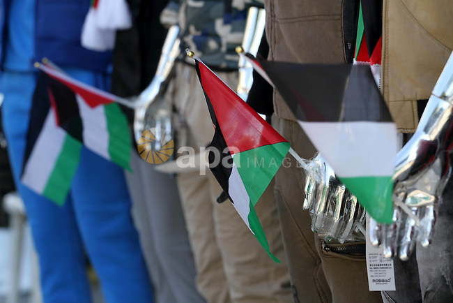 A Palestinian man display manikin wearing national clothes to show solidarity with the al-Aqsa mosque compound ana palestinians in the West Bank, at his shop, in Gaza city, on Nov. 01, 2015. Photo by Mohammed Asad