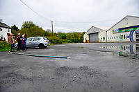 Pictured: Residents pump out water from the basement after flooding caused by Storm Callum, in Carmathen, Wales, UK. Sunday 14 October 2018<br /> Re: The aftermath of the flood caused by the unusually high tide of rover Towy and storm Callum in Carmarthen west Wales, UK.