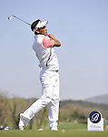 JEJU, SOUTH KOREA - APRIL 25:  Thongchai Jaidee of Thailand tees off on the 14th hole during the Round Three of the Ballantine's Championship at Pinx Golf Club on April 25, 2010 in Jeju, South Korea. Photo by Victor Fraile / The Power of Sport Images