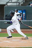 Keon Barnum (20) of the Winston-Salem Dash follows through on his swing against the Potomac Nationals at BB&T Ballpark on April 30, 2015 in Winston-Salem, North Carolina.  The Nationals defeated the Dash 5-4..  (Brian Westerholt/Four Seam Images)