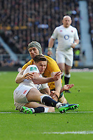 Owen Farrell of England tussles with David Pocock of Australia on the English tryline during the Old Mutual Wealth Series match between England and Australia at Twickenham Stadium on Saturday 3rd December 2016 (Photo by Rob Munro)