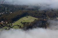 aerial photograph of the San Francisco National Cemetery through layers of fog, Presidio, San Francisco, California