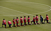 KANSAS CITY, KS - SEPTEMBER 19: FC Dallas take a knee during the National Anthem performance during a game between FC Dallas and Sporting Kansas City at Children's Mercy Park on September 19, 2020 in Kansas City, Kansas.