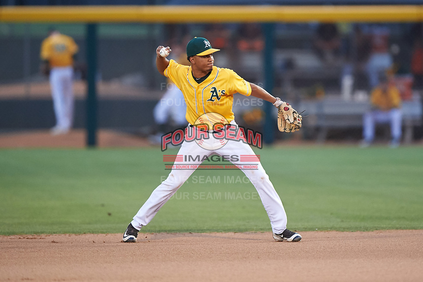 AZL Athletics Gold second baseman Christopher Quintin (2) throws to first base during an Arizona League game against the AZL Giants Black on July 12, 2019 at Hohokam Stadium in Mesa, Arizona. The AZL Giants Black defeated the AZL Athletics Gold 9-7. (Zachary Lucy/Four Seam Images)