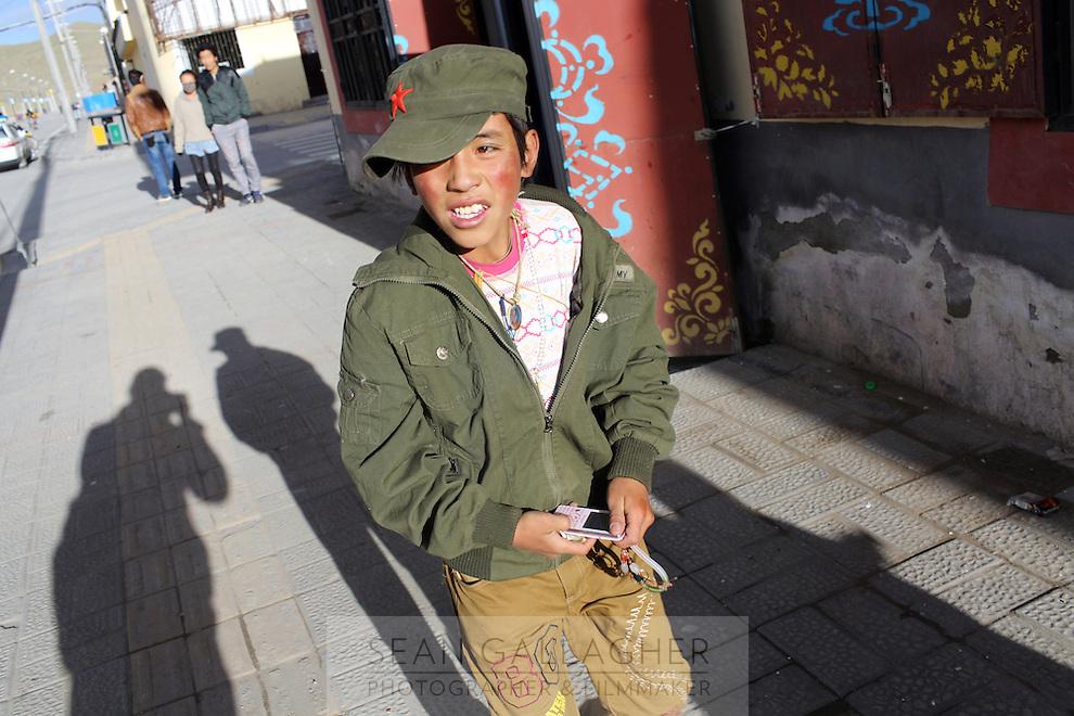 A Tibetan boy in a town on the Tibetan Plateau, in western China.