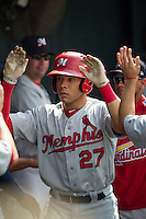 Memphis Redbirds outfielder Thomas Pham (27) is greeted in the dugout after scoring during the first game of a Pacific Coast League doubleheader against the Round Rock Express on August 3, 2014 at the Dell Diamond in Round Rock, Texas. The Redbirds defeated the Express 4-0. (Andrew Woolley/Four Seam Images)