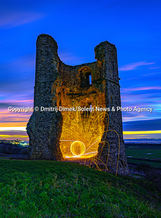 "Pictured:  Hadleigh Castle, Essex<br /> <br /> Amazing photos show sparks illuminating British landmarks as they fly from what appears to be a disc of colourful light.  This unique effect is the result of long-exposure night-time shots of a whisk stuffed with steel wool, which is set alight and spun at the end of a metal chain.<br /> <br /> Amateur photographer Dmitrij Dimek is passionate about what he calls 'light paintings', and took these photos at castles, beaches and other settings around Essex and London.  The 38 year old, who grew up in Poland but now lives in Southend-on-Sea, Essex, said: ""When I first found out about light painting with steel wool, I thought it was an outstanding way to connect with photography.  SEE OUR COPY FOR DETAILS.<br /> <br /> Please byline: Dmitrij Dimek/Solent News<br /> <br /> © Dmitrij Dimek/Solent News & Photo Agency<br /> UK +44 (0) 2380 458800"