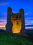 """Pictured:  Hadleigh Castle, Essex<br /> <br /> Amazing photos show sparks illuminating British landmarks as they fly from what appears to be a disc of colourful light.  This unique effect is the result of long-exposure night-time shots of a whisk stuffed with steel wool, which is set alight and spun at the end of a metal chain.<br /> <br /> Amateur photographer Dmitrij Dimek is passionate about what he calls 'light paintings', and took these photos at castles, beaches and other settings around Essex and London.  The 38 year old, who grew up in Poland but now lives in Southend-on-Sea, Essex, said: """"When I first found out about light painting with steel wool, I thought it was an outstanding way to connect with photography.  SEE OUR COPY FOR DETAILS.<br /> <br /> Please byline: Dmitrij Dimek/Solent News<br /> <br /> © Dmitrij Dimek/Solent News & Photo Agency<br /> UK +44 (0) 2380 458800"""
