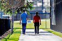 23 February 2019: Washington Nationals radio broadcasters Dave Jageler (left) and Charlie Slowes (right) walk down a backfield path from the practice fields prior to a Spring Training game against the Houston Astros at the Ballpark of the Palm Beaches in West Palm Beach, Florida. The Nationals walked off with a 7-6 Opening Game win to start the Grapefruit League season. Mandatory Credit: Ed Wolfstein Photo *** RAW (NEF) Image File Available ***