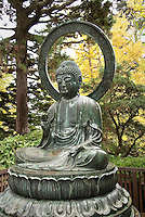 Japanese Tea Garden in Golden Gate Park, San Francisco, California. Bronze statue of Buddha.