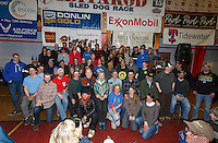 Alaska Governor Bill Walker and the first lady pose with most all of the 2015 Iditarod finishers at the finishers banquet in Nome on Sunday  March 22, 2015 during Iditarod 2015.  <br /> <br /> (C) Jeff Schultz/SchultzPhoto.com - ALL RIGHTS RESERVED<br />  DUPLICATION  PROHIBITED  WITHOUT  PERMISSION