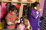 Preschool 3-5 year olds pretend play group of three girls two girls talking on telephones one girl styling hair horizontal