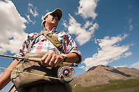 150620-JRE-7981E-0408  Joshua Quong, a teacher and quail hunting guide from Mississippi, prepares to hunt  Arctic Grayling with a fly rod.