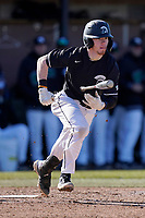 Damon Maynard (5) of the University of South Carolina Upstate Spartans bats in a game against the University of Toledo Rockets on Saturday, February 20, 2021, at Cleveland S. Harley Park in Spartanburg, South Carolina. Upstate won, 5-1. (Tom Priddy/Four Seam Images)