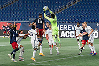 FOXBOROUGH, UNITED STATES - AUGUST 20: Andre Blake #18 of Philadelphia Union leaps to catch the ball as Brandon Bye #15 of New England Revolution attempts a header off a corner kick during a game between Philadelphia Union and New England Revolution at Gilette on August 20, 2020 in Foxborough, Massachusetts.