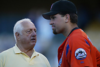 Mike Piazza of the New York Mets talks with former Los Angeles Dodgers manager Tommy Lasorda during a 2003 season MLB game at Dodger Stadium in Los Angeles, California. (Larry Goren/Four Seam Images)