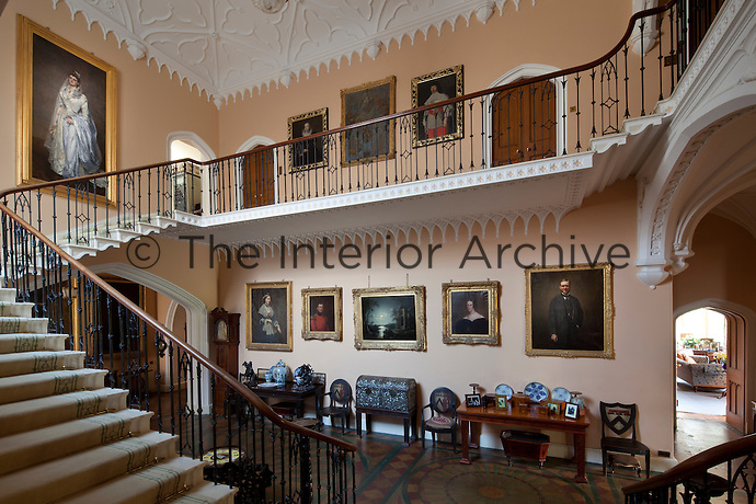 Victorian portraits line the walls of the staircase hall, remodelled in the Gothic Revival style in the late 18th/early 19th century. The cantilevered staircase was installed in the 1720s
