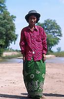CAMBODIA Mekong River, portrait of woman at shore / KAMBODSCHA Mekong Fluss, Portraet einer Frau am Ufer