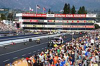 Feb 8, 2015; Pomona, CA, USA; Overall view of Auto Club Raceway at Pomona as NHRA top fuel driver Larry Dixon races alongside Richie Crampton during the Winternationals. Mandatory Credit: Mark J. Rebilas-