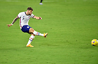 ORLANDO CITY, FL - JANUARY 31: Paul Arriola #7 of the United States takes a shot during a game between Trinidad and Tobago and USMNT at Exploria stadium on January 31, 2021 in Orlando City, Florida.
