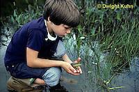 FA27-098z  Boy releasing frog at pond