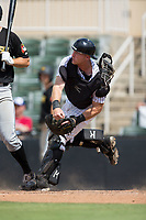 Kannapolis Intimidators catcher Casey Schroeder (17) makes a throw to second base against the West Virginia Power at Kannapolis Intimidators Stadium on June 18, 2017 in Kannapolis, North Carolina.  The Intimidators defeated the Power 5-3 to win the South Atlantic League Northern Division first half title.  It is the first trip to the playoffs for the Intimidators since 2009.  (Brian Westerholt/Four Seam Images)