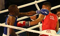 BARRANQUILLA - COLOMBIA, 25-07-2018: MARTINEZ MEZA Jhon W. (Colombia) vs JONES Ajayi Taiwo (Barbados) durante su participación en boxeo masculino categoría gallo (56kg) como parte de los Juegos Centroamericanos y del Caribe Barranquilla 2018. /  MARTINEZ MEZA Jhon W. (Colombia) vs JONES Ajayi Taiwo (Barbados) during their participation in the boxing men's bantam (56kg) category of the Central American and Caribbean Sports Games Barranquilla 2018. Photo: VizzorImage / Cont