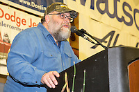 The Golden Clipboard Award for the best checkpoint is announced by Mark Nordman, race marshal, to the checkpoint of Nulato at the musher finisher's banquet in Nome during the 2016 Iditarod.  Alaska    <br /> <br /> Photo by Jeff Schultz (C) 2016  ALL RIGHTS RESERVED