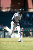 Glendale Desert Dogs right fielder Estevan Florial (13), of the New York Yankees organization, runs to first base during an Arizona Fall League game against the Mesa Solar Sox at Sloan Park on October 27, 2018 in Mesa, Arizona. Glendale defeated Mesa 7-6. (Zachary Lucy/Four Seam Images)