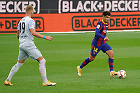 19th December 2020; Camp Nou, Barcelona, Catalonia, Spain; La Liga Football, Barcelona versus Valencia;  Coutinho of Barcelona cuts away from the challenge of Racic of Valencia