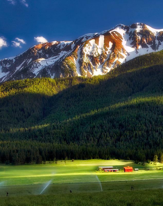 Farmland near Joseph with barn and Wallowa Mountains. Oregon
