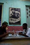 "chess players under a wallpost of ""El Che"" in Santiago de Cuba."