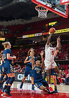 COLLEGE PARK, MD - NOVEMBER 20: Kaila Charles #5 of Maryland crashes into Olivia Gumbs #12 of George Washington as she shoots during a game between George Washington University and University of Maryland at Xfinity Center on November 20, 2019 in College Park, Maryland.