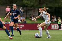 NEWTON, MA - AUGUST 29: Andi Barth #21 of Boston College passes the ball during a game between University of Connecticut and Boston College at Newton Campus Soccer Field on August 29, 2021 in Newton, Massachusetts.