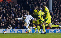 12.12.2013 London, England. Tottenham Hotspur midfielder Etienne Capoue (15) tripped in the box by Anzhi Makhachkala midfielder Jucilei (8) for a penalty during the Europa League game between Tottenham Hotspur and Anzhi Makhachkala from White Hart Lane.