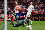 Joao Felix of Atletico de Madrid and Sergio Ramos and Thibaut Courtois of Real Madrid during La Liga match between Atletico de Madrid and Real Madrid at Wanda Metropolitano Stadium{ in Madrid, Spain. {iptcmonthname} 28, 2019. (ALTERPHOTOS/A. Perez Meca)