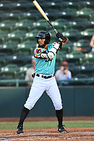 Miguel Aparicio (5) of Las Llamas de Hickory at bat during a game against Los Rapidos de Kannapolis at L.P. Frans Stadium on July 17, 2019 in Hickory, North Carolina. The Llamas defeated the Rapidos 7-5. (Tracy Proffitt/Four Seam Images)