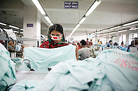 Female worker checking the products at a garments factory in Gazipur, near Dhaka, Bangladesh