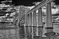 A black and white view of the Firth of Forth railway bridge in Scotland