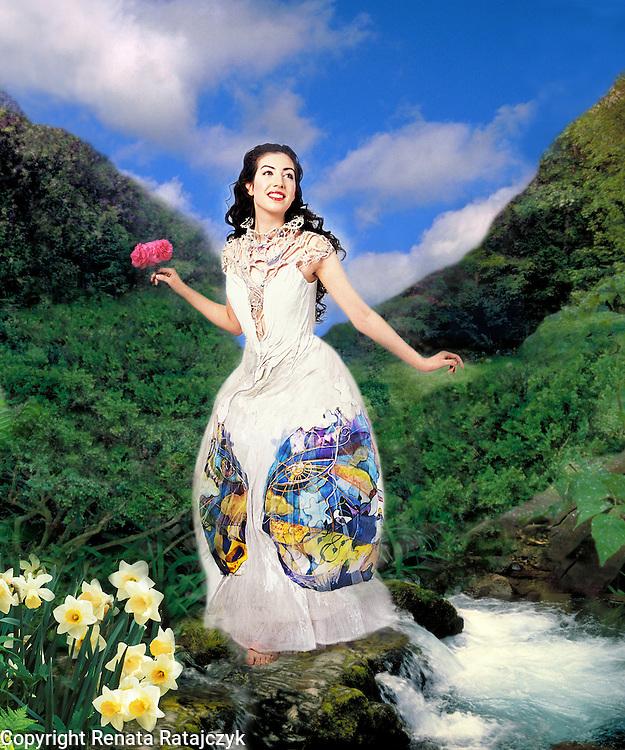 Fantasy Art - A girl in a white dress in a fantasy landscape. Digitally enhanced creative portrait.