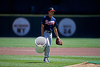 SAN FRANCISCO, CA - Greg Maddux of the Atlanta Braves carries the ball bucket during batting practice before a game against the San Francisco Giants at Candlestick Park in San Francisco, California July 29, 1995. (Photo by Brad Mangin)