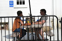 Cassie Holder of Pea Ridge (from left) and Elliot Holder chat as they enjoy their drinks, Friday, July 23, 2021 at Ozark Beer Company in Rogers. They expanded their patio area and added to their capacity. The brewery is in downtown Rogers and was the second largest beer producer in the state in 2019. Check out nwaonline.com/210724Daily/ for today's photo gallery. <br /> (NWA Democrat-Gazette/Charlie Kaijo)