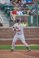 Michael Emodi (19) of the Idaho Falls Chukars at bat against the Orem Owlz at Melaleuca Field on July 14, 2019 in Idaho Falls, Idaho. The Owlz defeated the Chukars 6-2. (Stephen Smith/Four Seam Images)