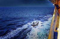 Pilot boat approaching cruise ship to pick up pilot.