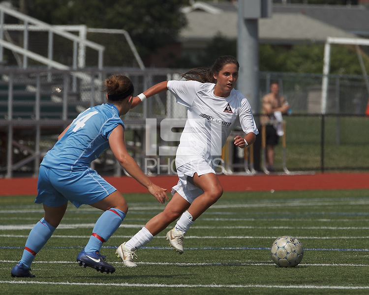 Boston Aztec midfielder Alexa St. Martin (20) on the attack.  In a Women's Premier Soccer League (WPSL) match, Boston Aztec (white) defeated Seacoast United Mariners (blue), 2-1, at North Reading High School Stadium on Arthur J. Kenney Athletic Field on on June 23, 2013. Due to injuries through the season, Seacoast United Mariners could only field 10 players.