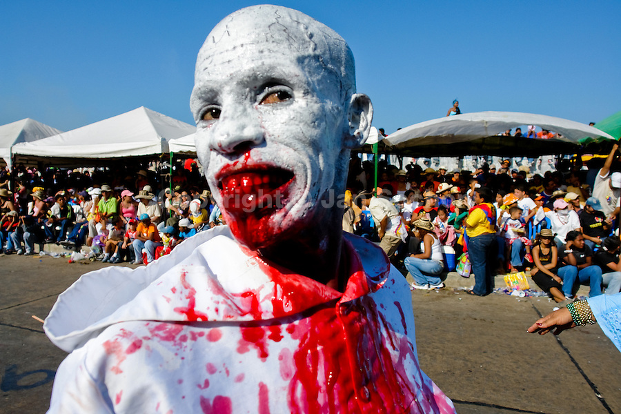 A Colombian man, wearing a vampire mask with bloody teeth, dances during the Carnival in Barranquilla, Colombia, 25 February 2006. The Carnival of Barranquilla is a unique festivity which takes place every year during February or March on the Caribbean coast of Colombia. A colourful mixture of the ancient African tribal dances and the Spanish music influence - cumbia, porro, mapale, puya, congo among others - hit for five days nearly all central streets of Barranquilla. Those traditions kept for centuries by Black African slaves have had the great impact on Colombian culture and Colombian society. In November 2003 the Carnival of Barranquilla was proclaimed as the Masterpiece of the Oral and Intangible Heritage of Humanity by UNESCO.