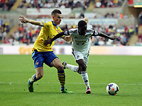 Saturday 28 September 2013<br /> Pictured: Nathan Dyer of Swansea (R) against Laurent Koscielny of Arsenal (L).<br /> Re: Barclay's Premier League, Swansea City FC v Arsenal at the Liberty Stadium, south Wales.