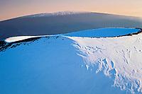 snow covered cinder cone on Mauna Kea, looking toward Mauna Loa in background, Big Island, Hawaii, Pacific Ocean